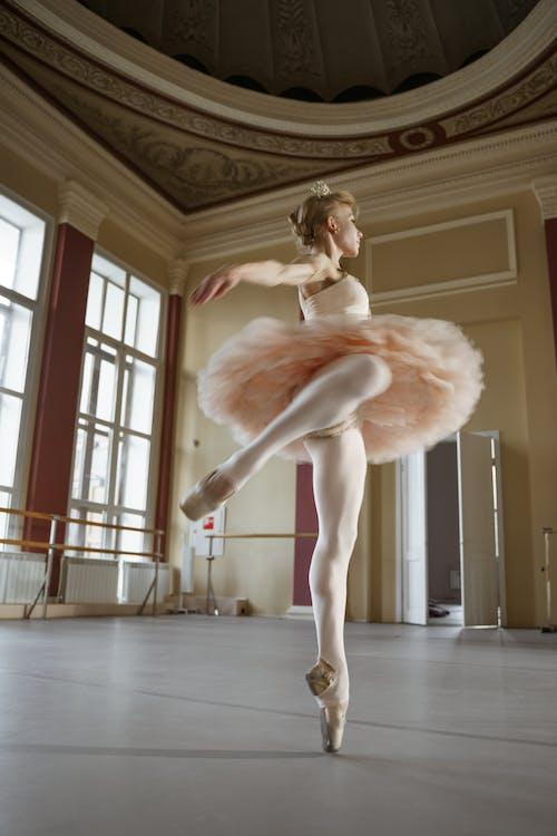 Ballerina Dancing in a Studio