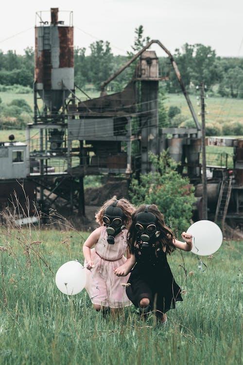 Running Children wearing Gas Mask