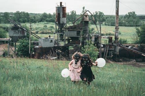 Children wearing Gas Mask running Together