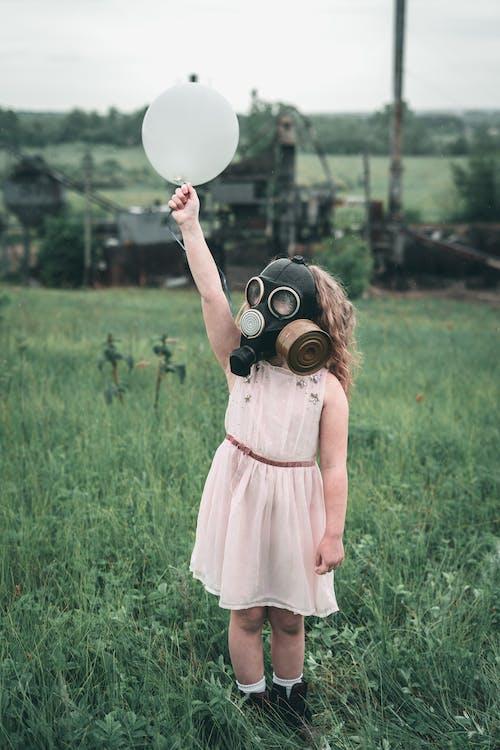 Kid in Pink Dress wearing Gas Mask