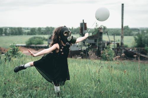 Girl in Black Dress wearing Gas Mask