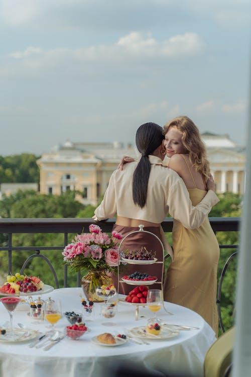 Women Hugging on the Balcony