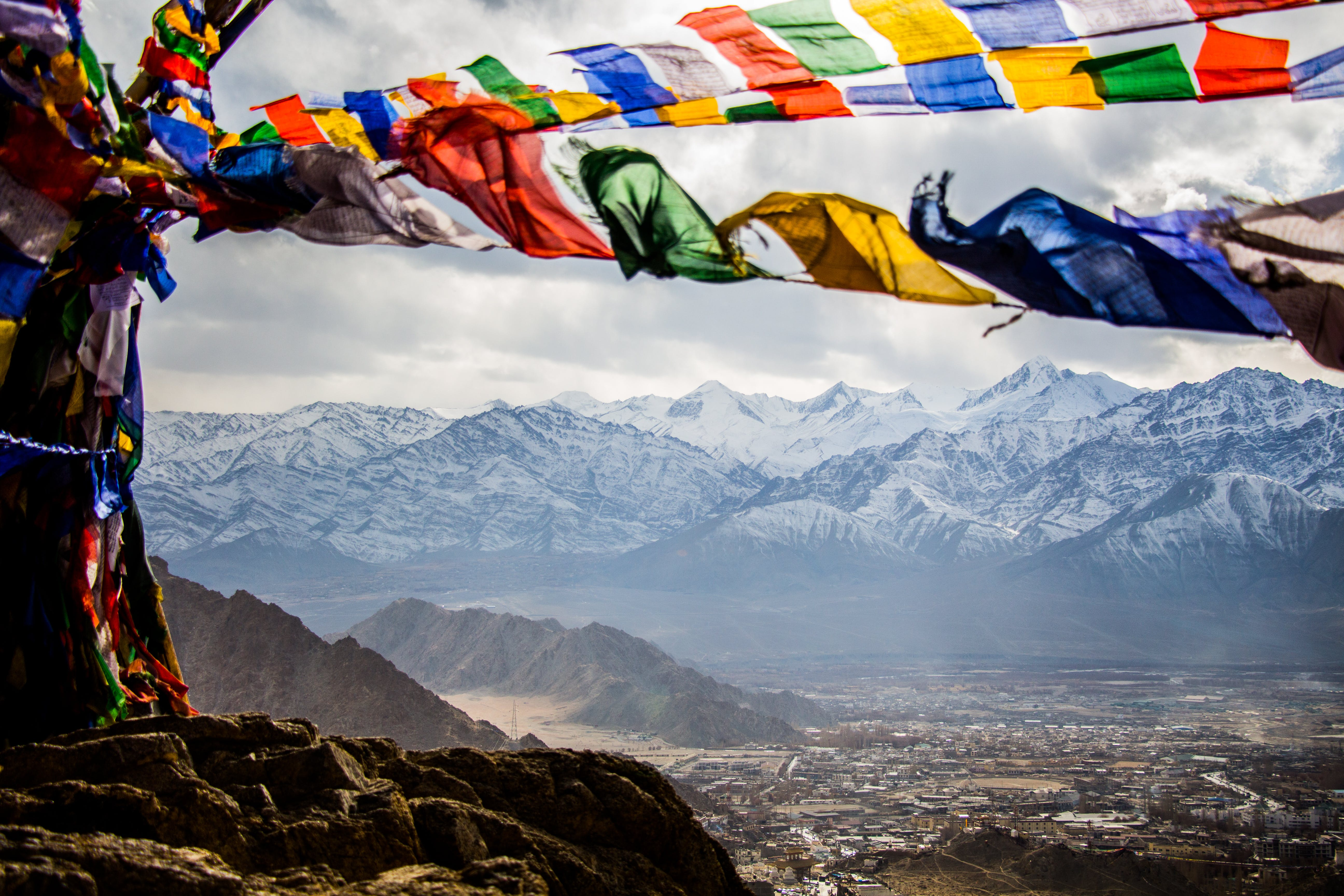 Assorted-color Banners on Mountain