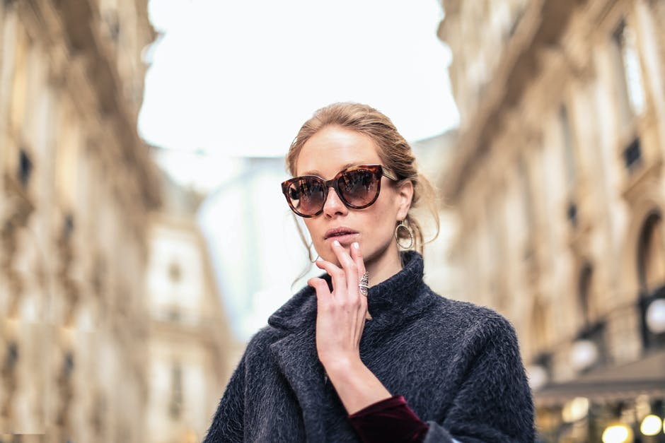 Woman Wearing Black Coat and Brown Framed Sunglasses