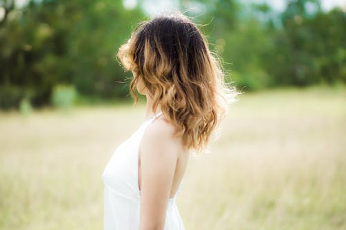 Selective Focus Photo of a Woman's Hair