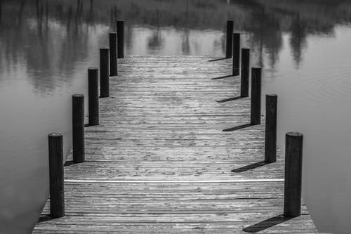 Grayscale Photography of Wooden Dock