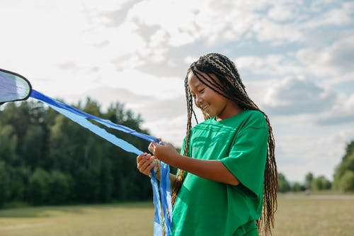 A Girl Holding a Kite