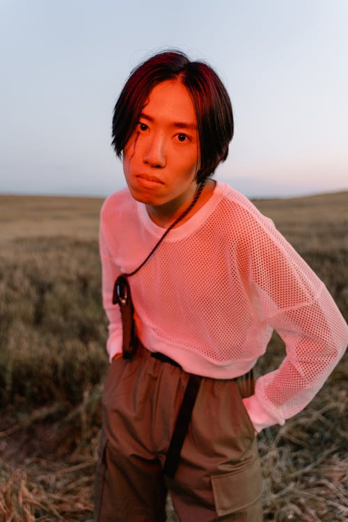 A Yong Man Standing on the Grass