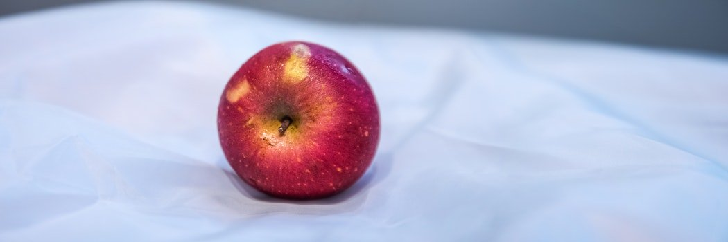 Red Apple Fruit on White Textile