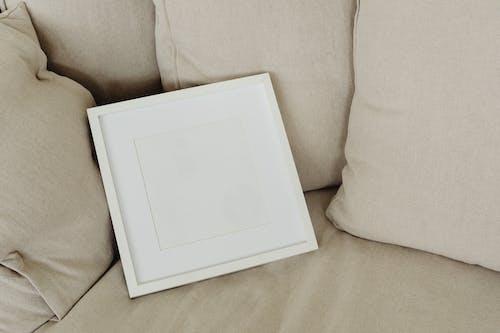 White Box on Gray Sofa