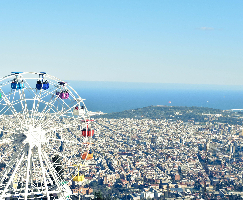 White Ferris Wheel Near Cityscape