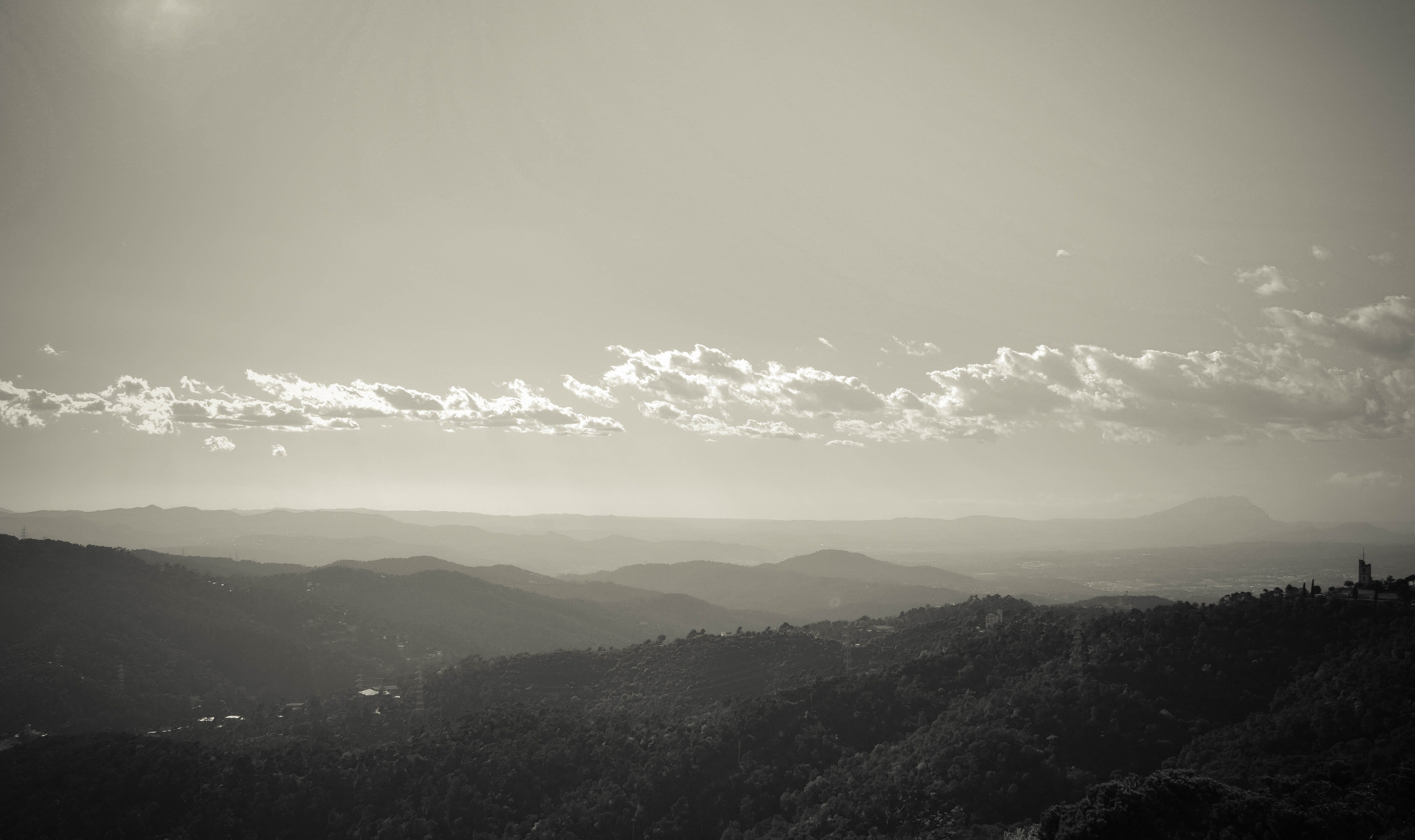 Mountain Range during Daytime Grey Scale Photography