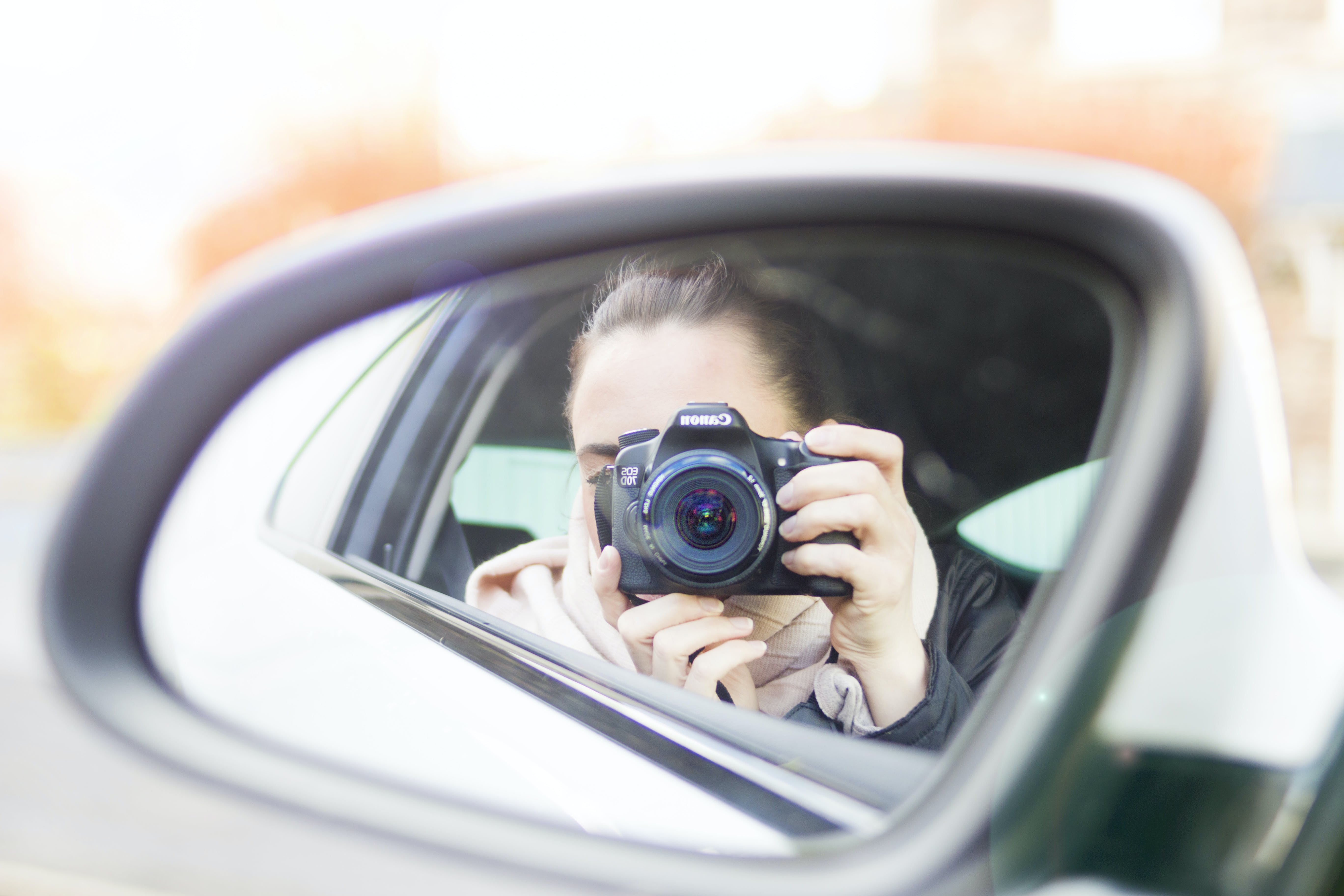 Close-up Photography of Woman Taking a Photo