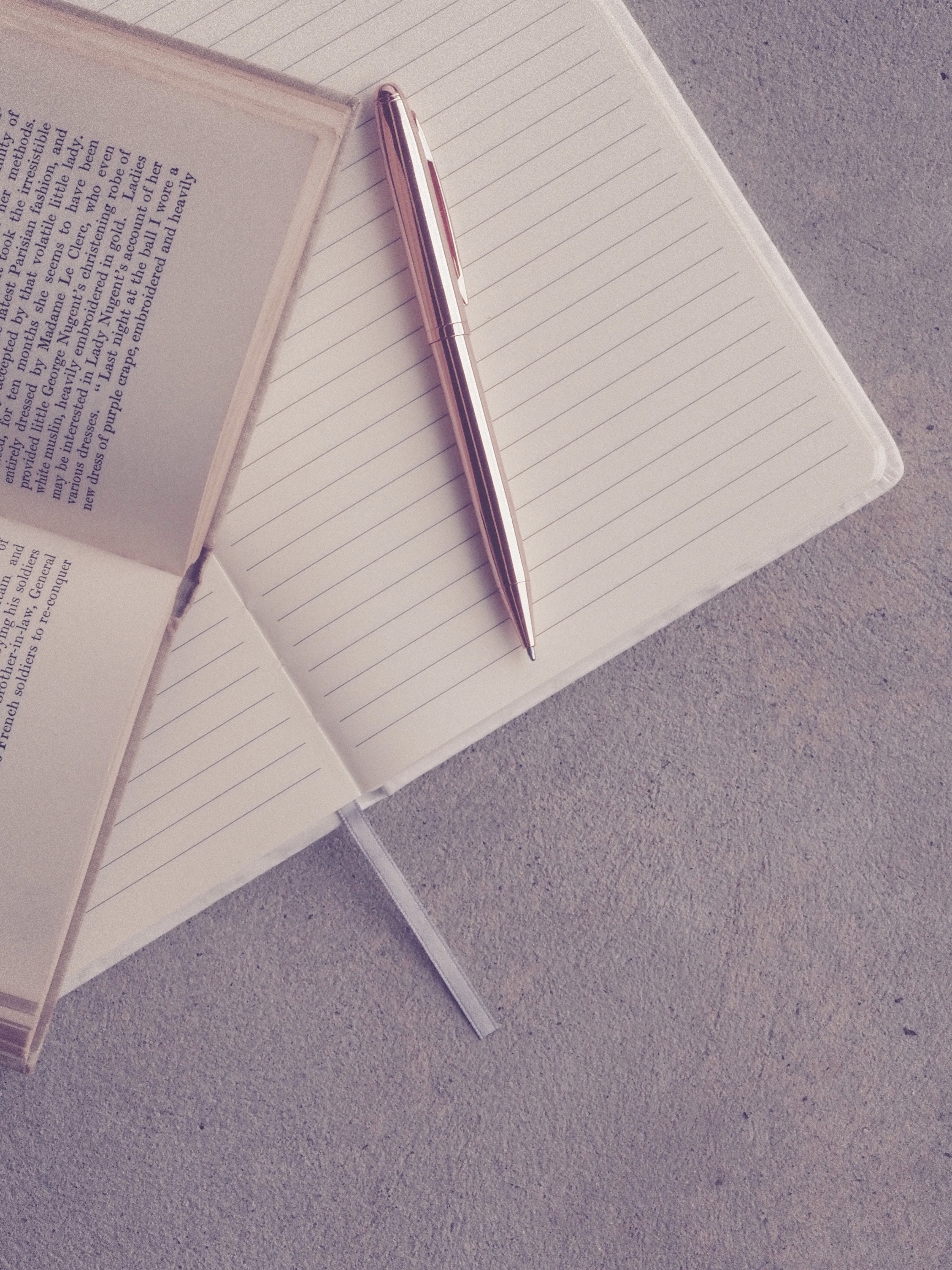 Book and Pen on Notebook