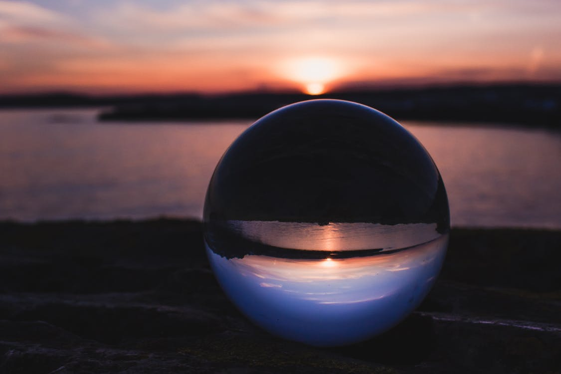 Close-Up Photography of Crystal Ball During Dawn