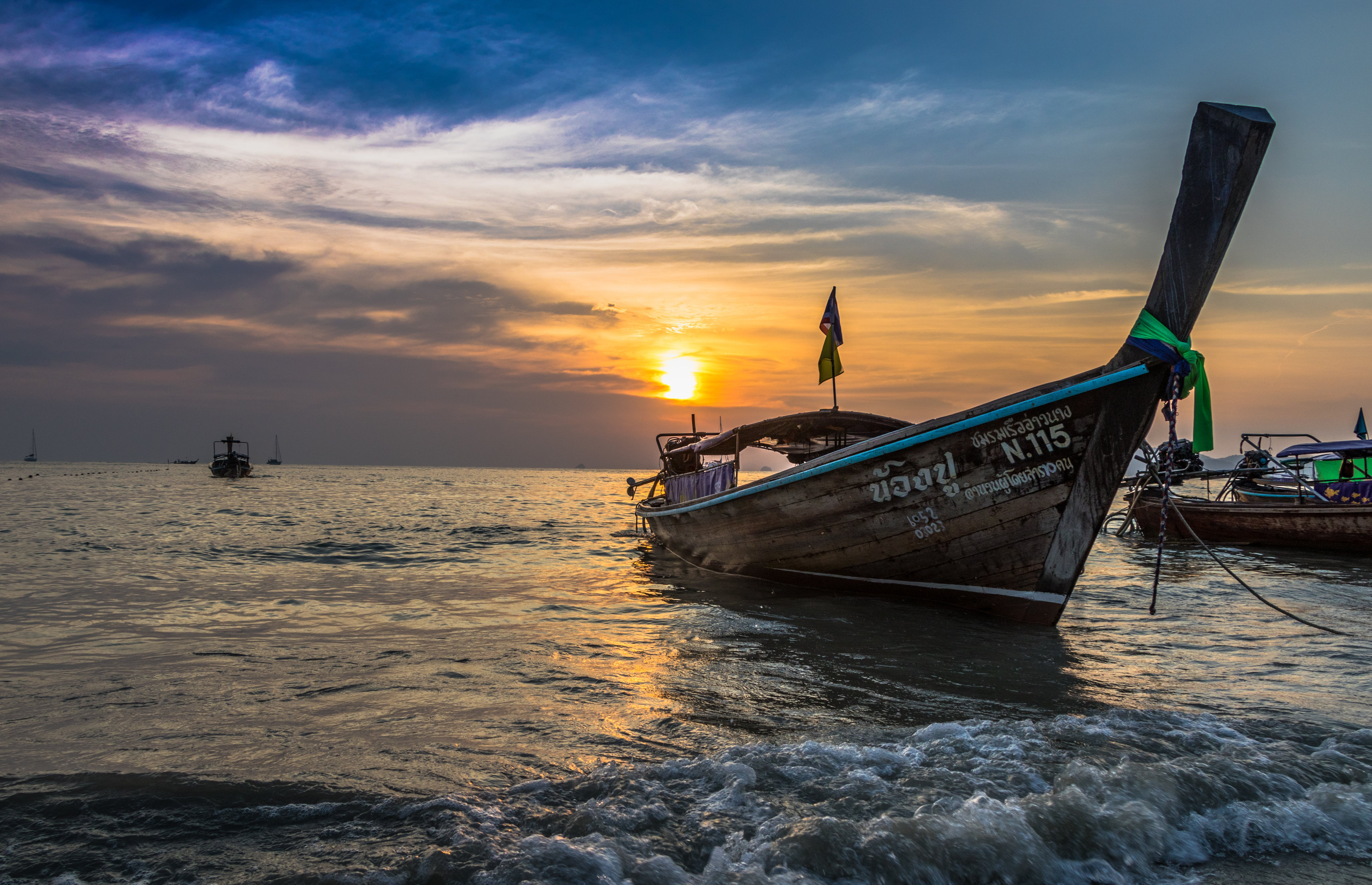 Photo of Brown Boat at Sea during Golden Hour