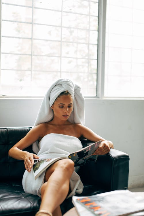Woman in White Towel Reading Book