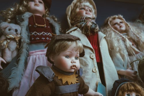 Boy in Brown and Beige Coat Doll