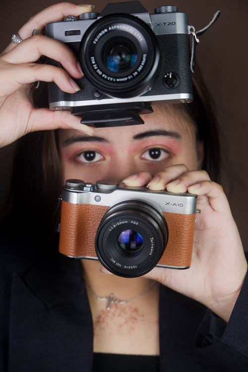 Woman Holding Black and Silver Camera