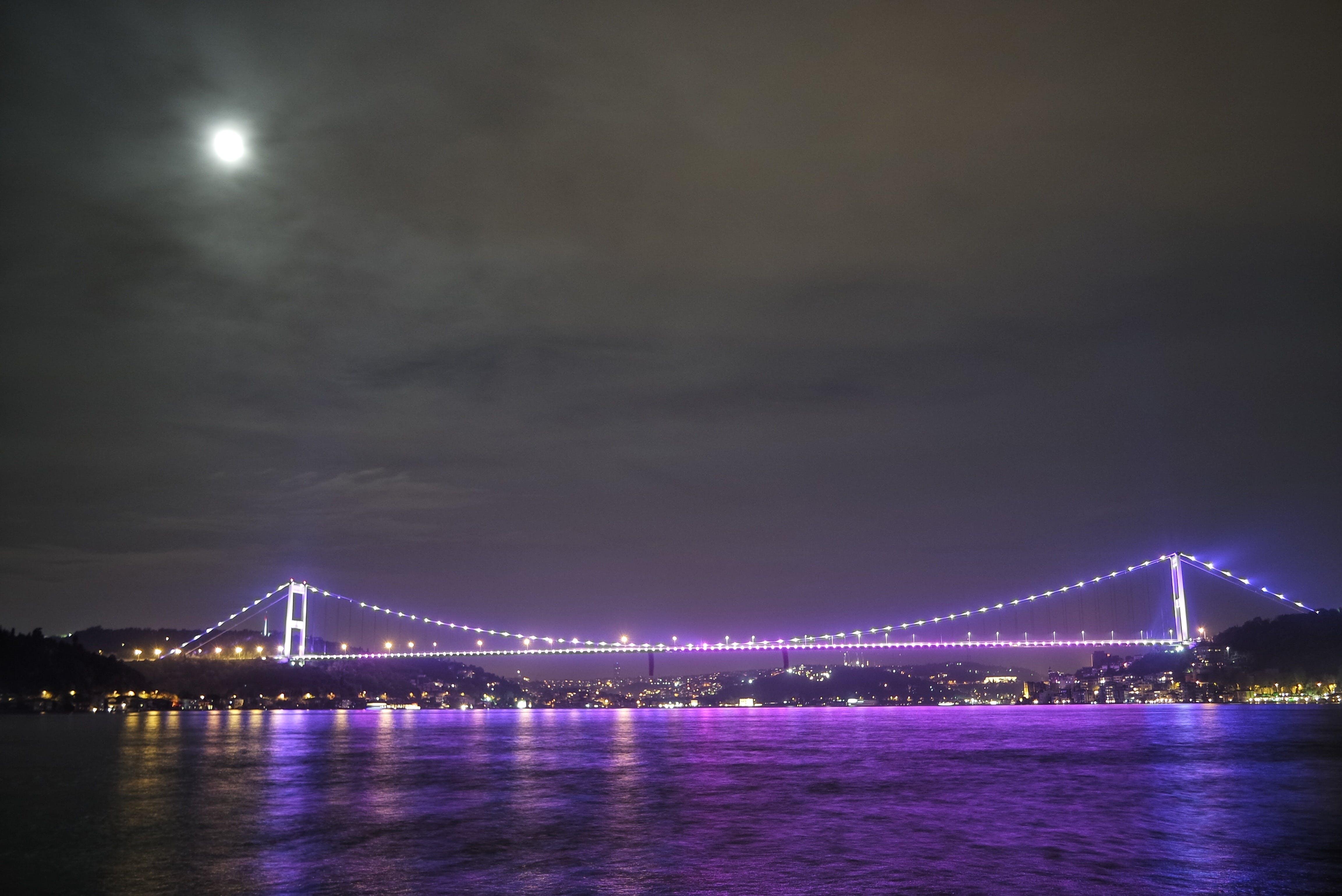 Purple Light on Bride Across Body of Water