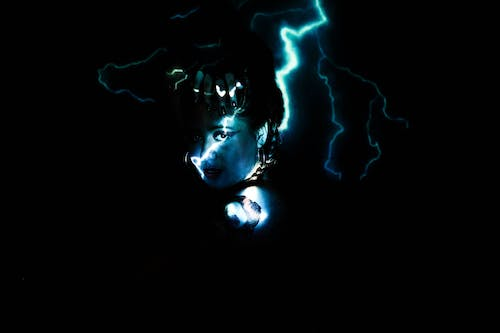 Woman With Blue and White Lights