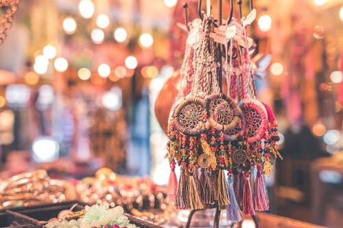 Person Showing Assorted Dream Catcher Keychain Lot in Tilt Shift Photography \
