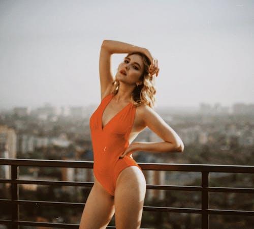 Woman in Orange One Piece Swimsuit