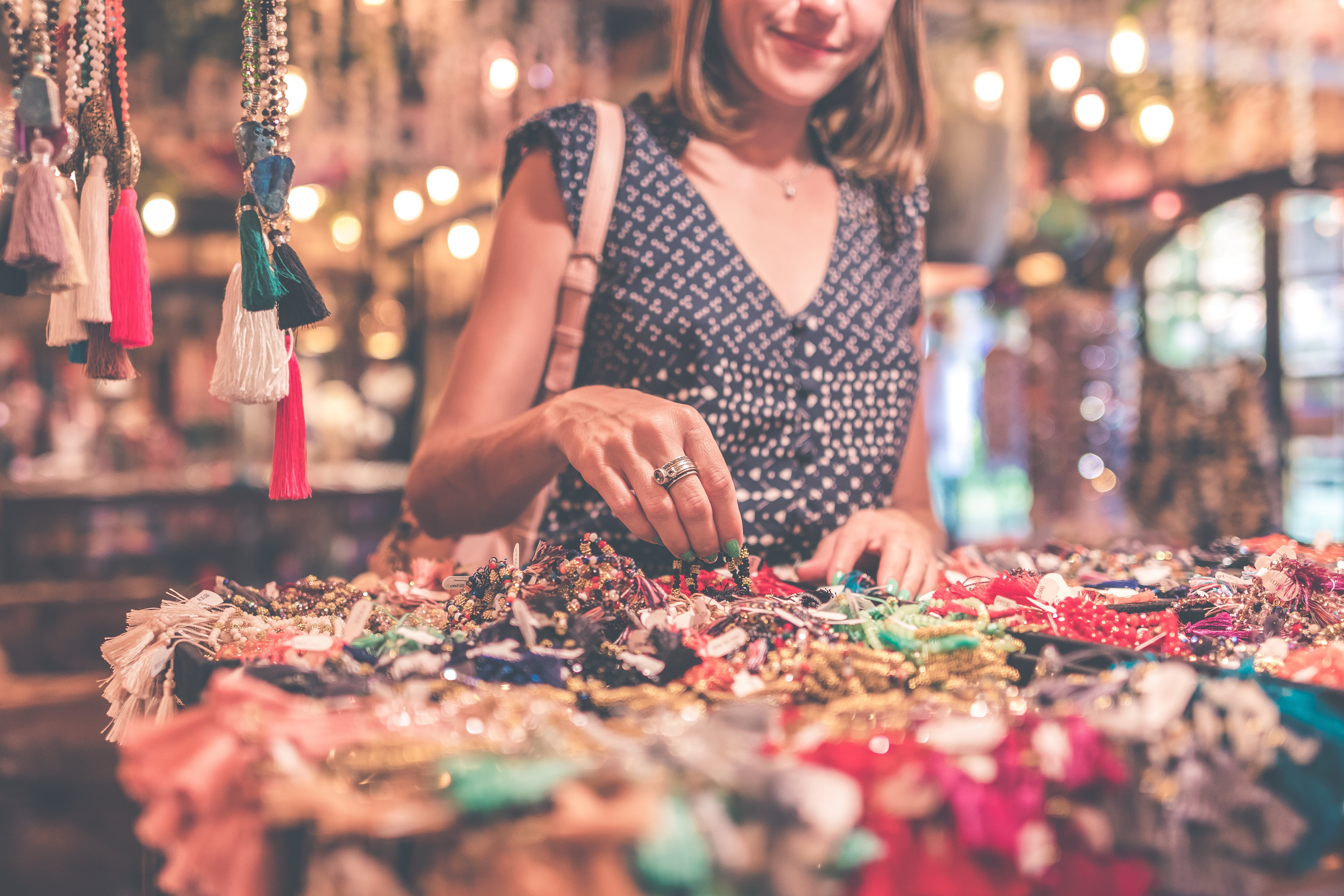 Woman Selecting Beaded Jewelry