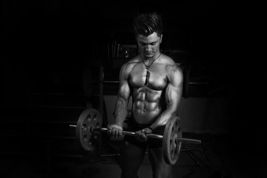 Grayscale Photography of Man Carrying Barbell