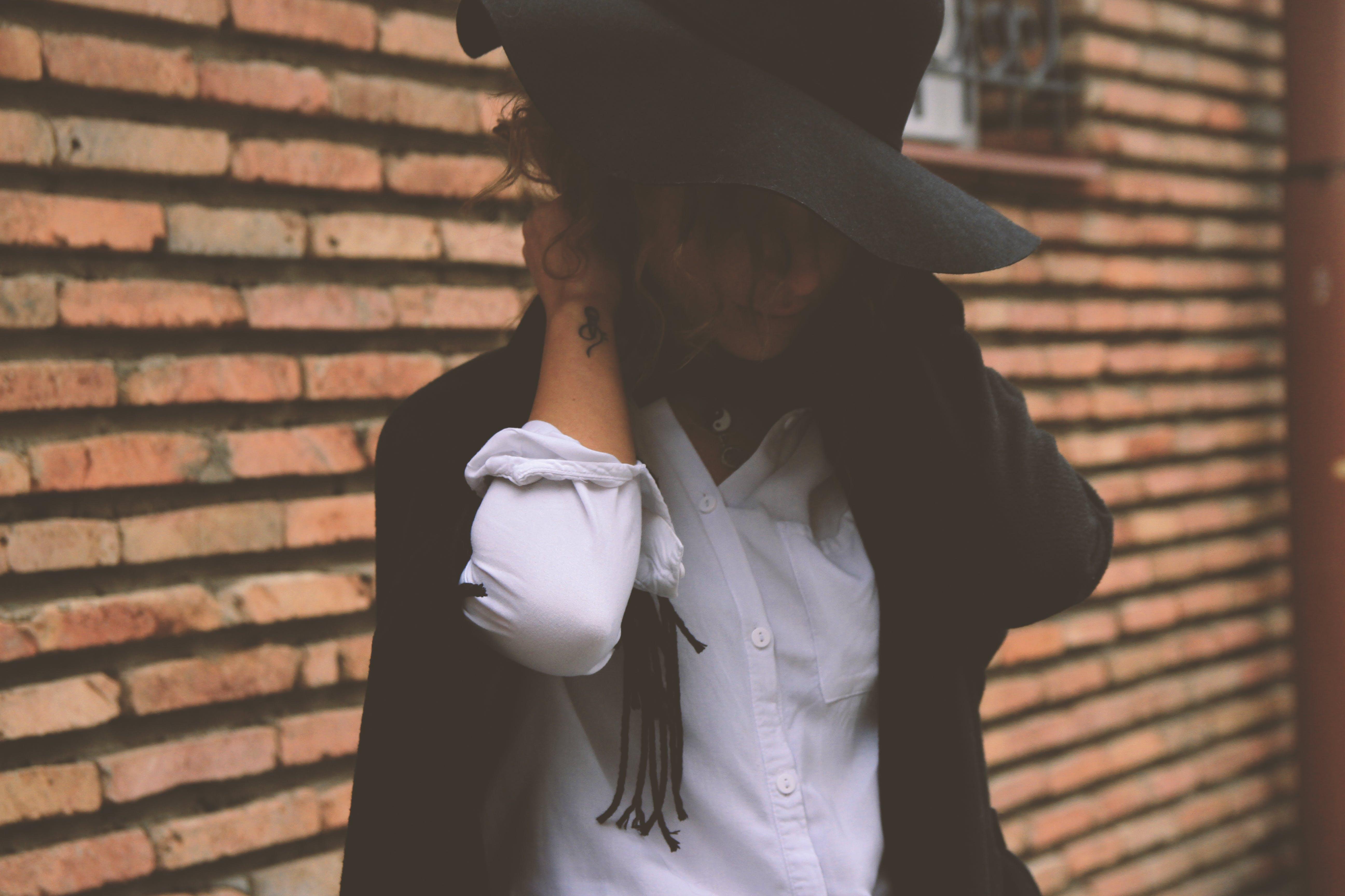 Woman Wearing White Dress Shirt and Black Coat