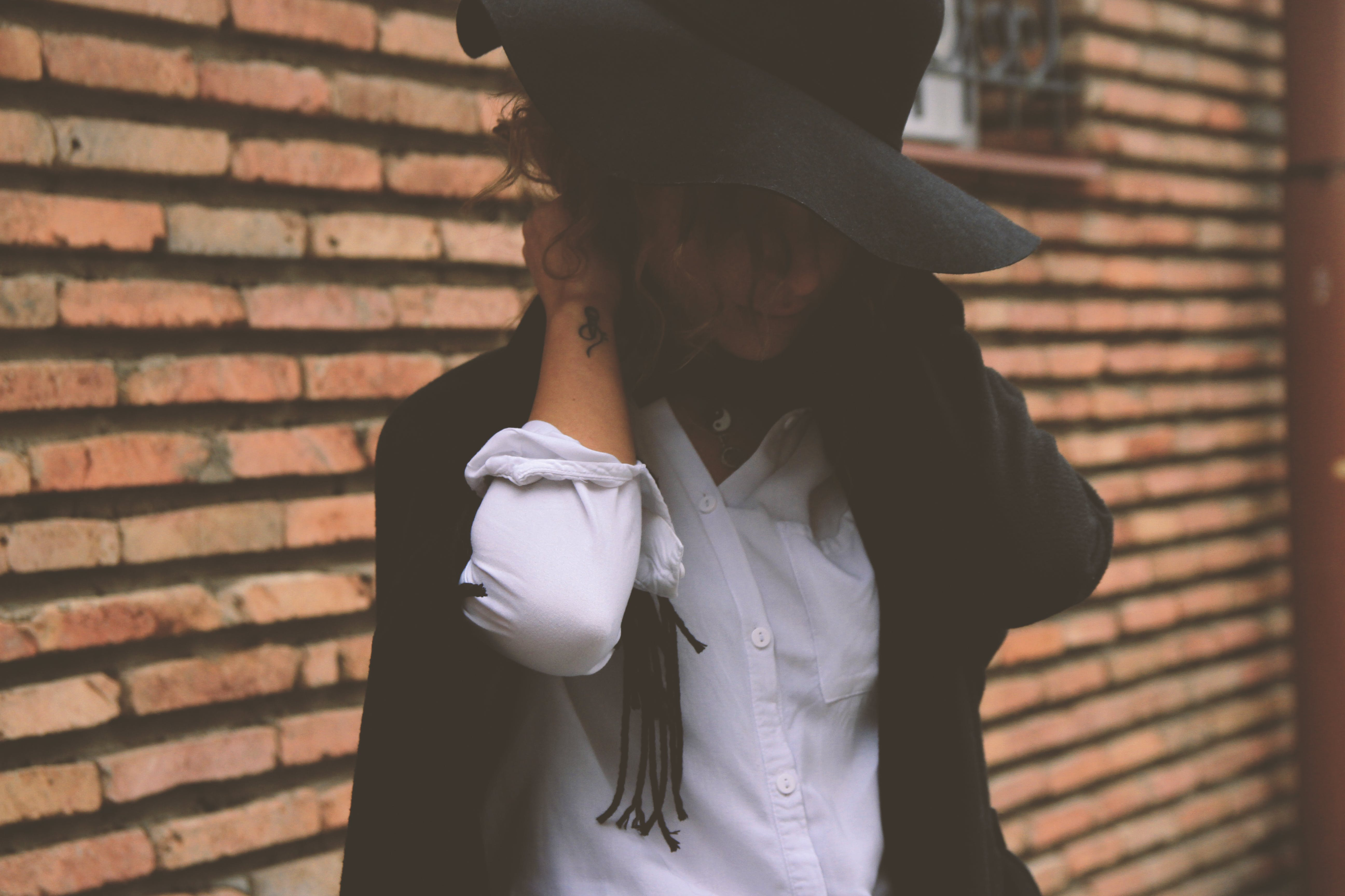 Woman Wearing White Dress Shirt and Black Coat
