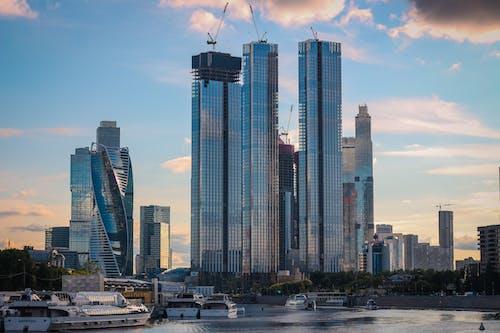 Tall Glass Buildings Under Blue Sky