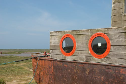 Rusted Boat with Brown Wooden Cabin
