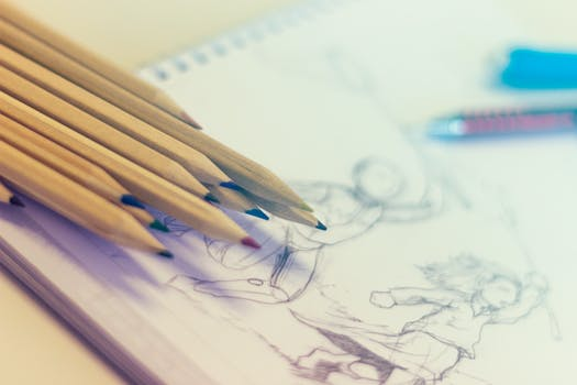An image of pencils over a sketch of a man.