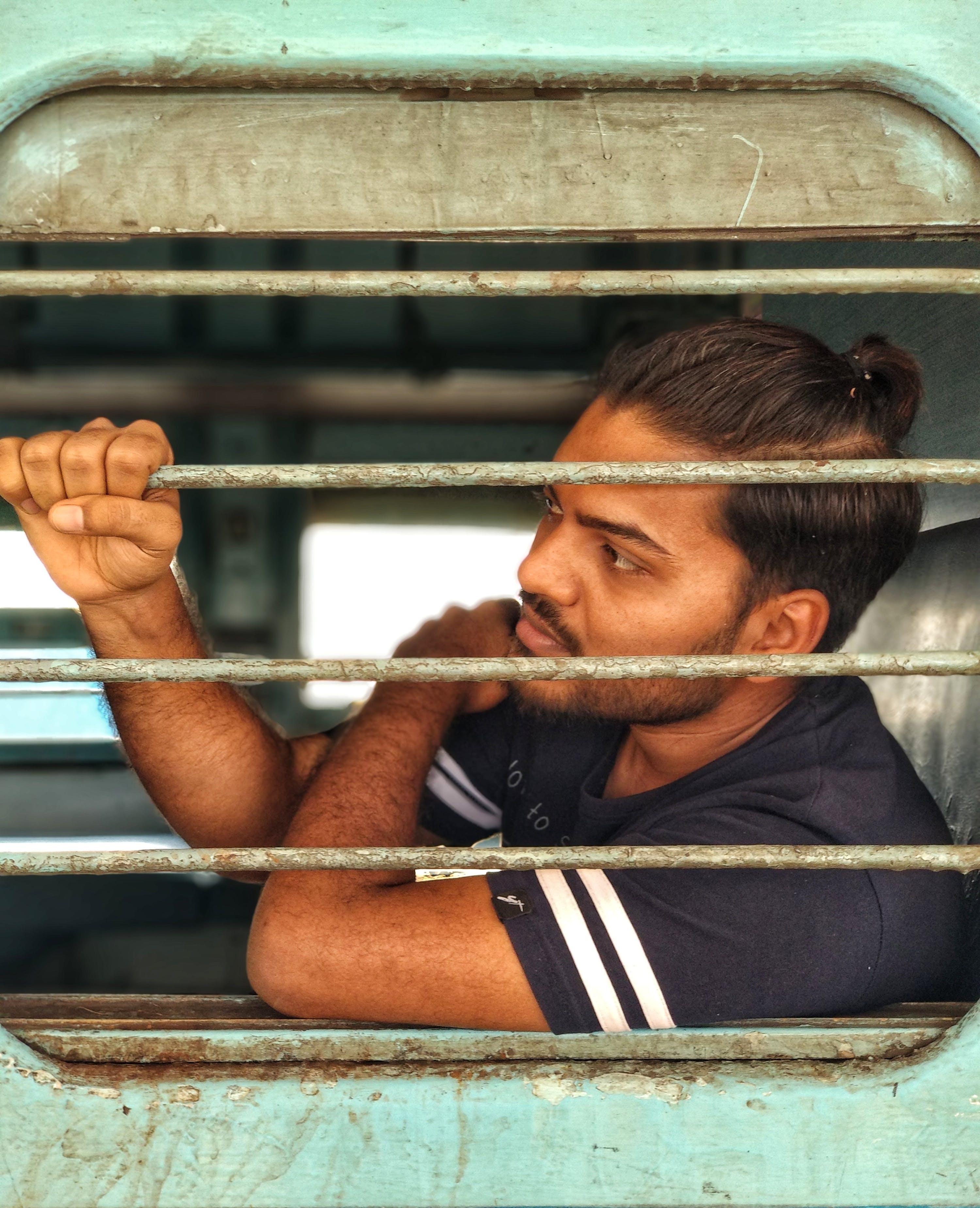 Man Wearing Black Crew-neck T-shirt Inside Green Vehicle