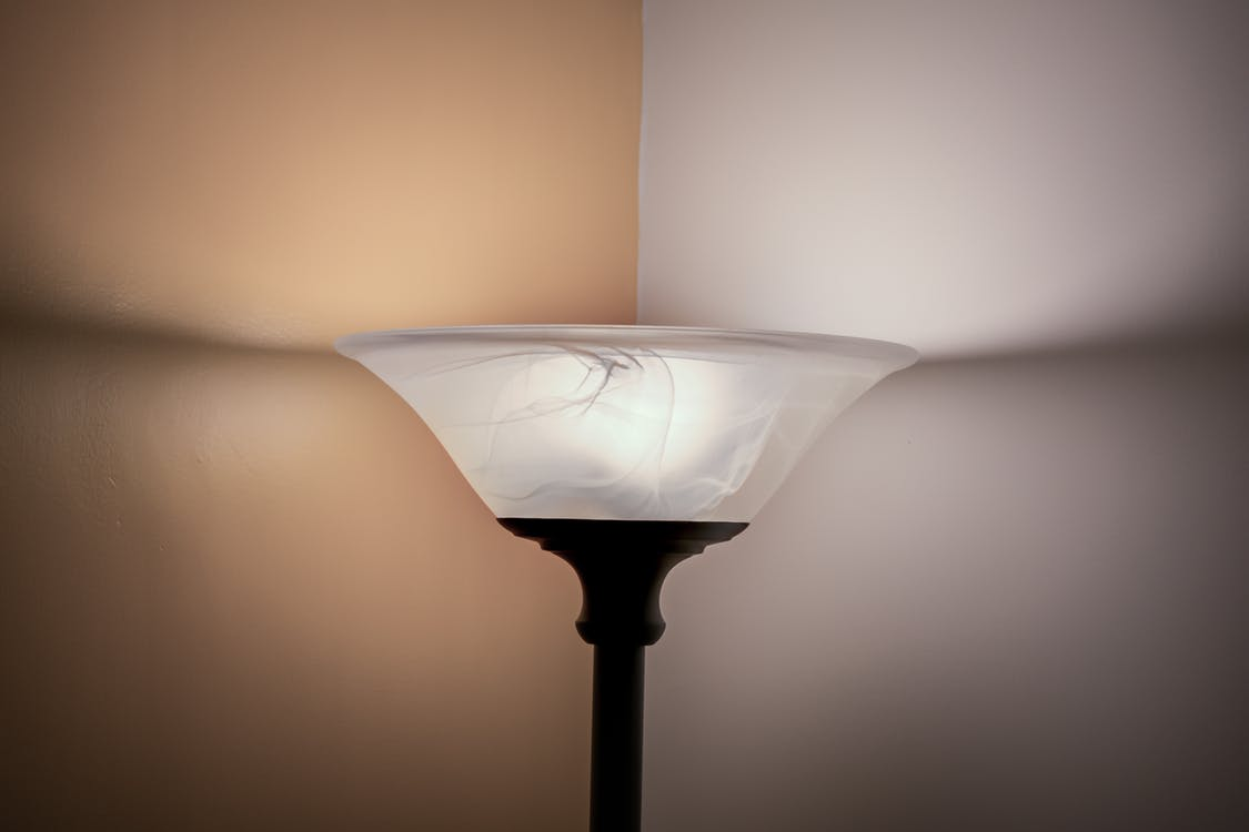 Turned on White and Black Torchiere Lamp
