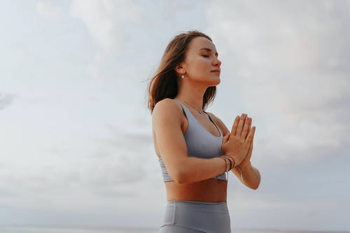 Close-Up Shot of a Woman Doing a Yoga Exercise during Morning