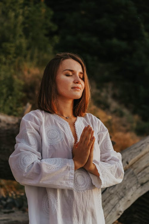 A Woman with Short Hair Meditating
