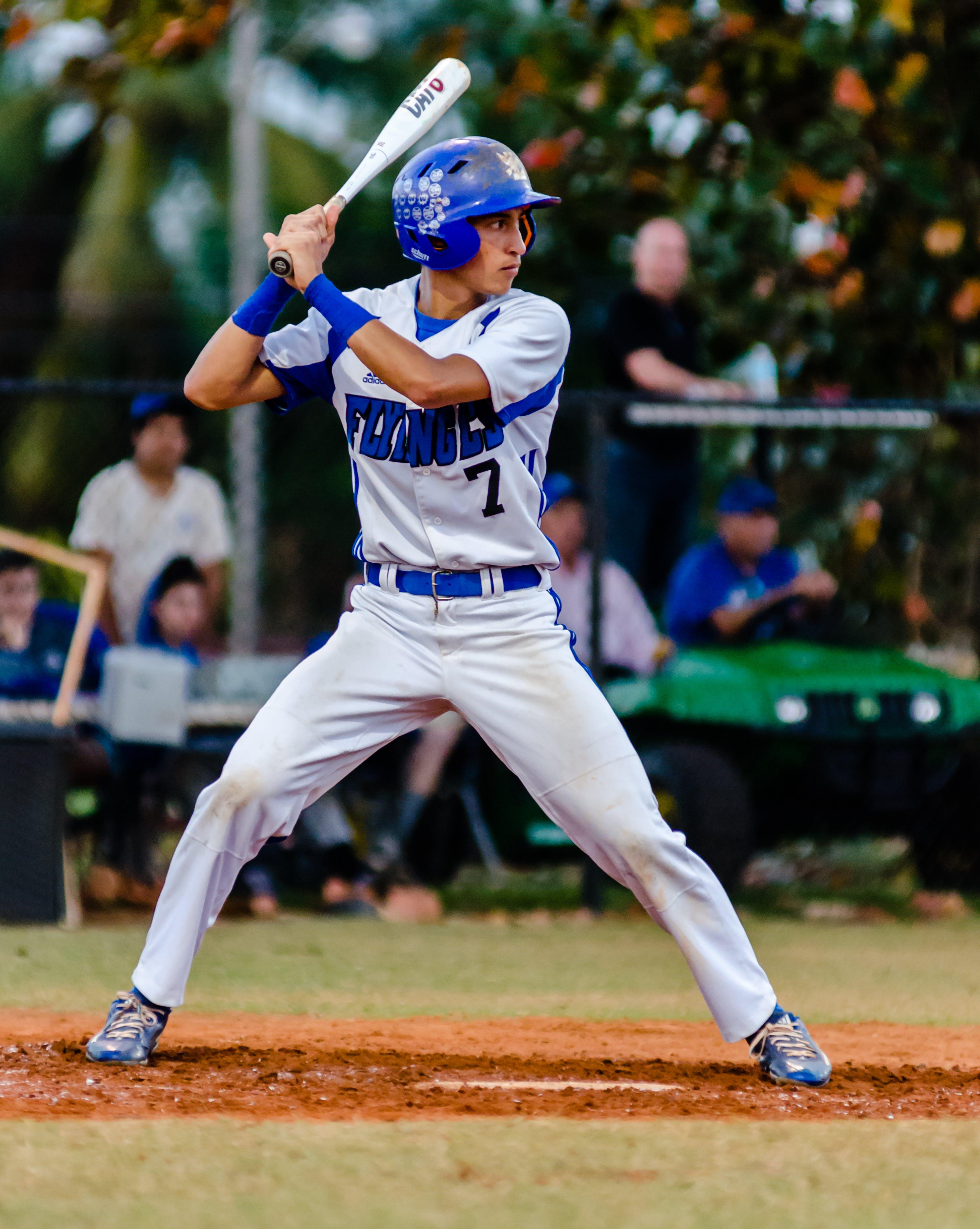 Person Holding Baseball Bat