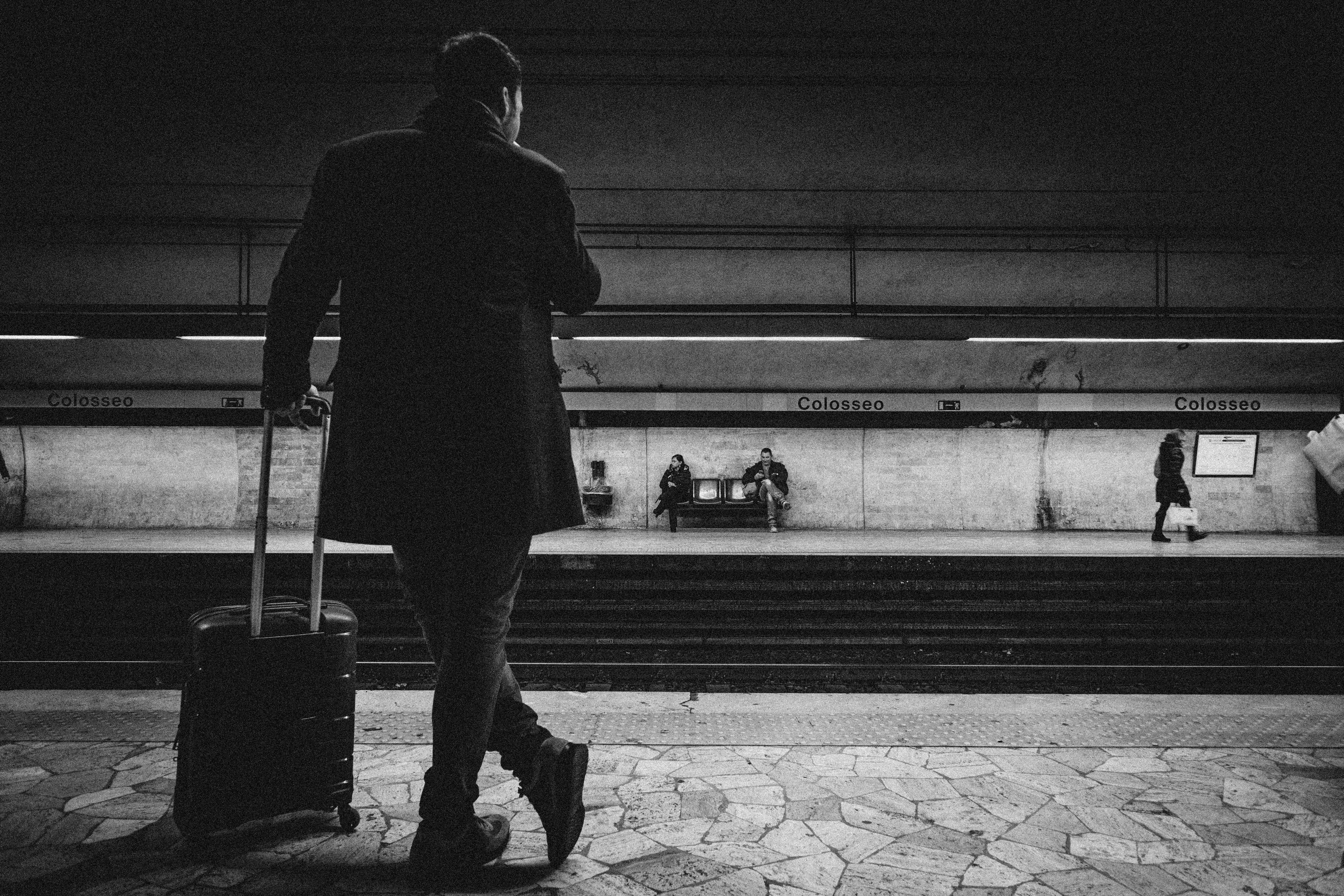 Man With Luggage Bag on Train Station