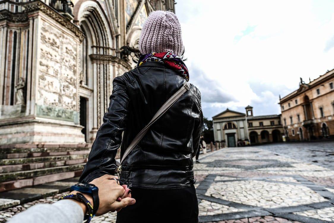 Photo of Man Holding Woman's Hand