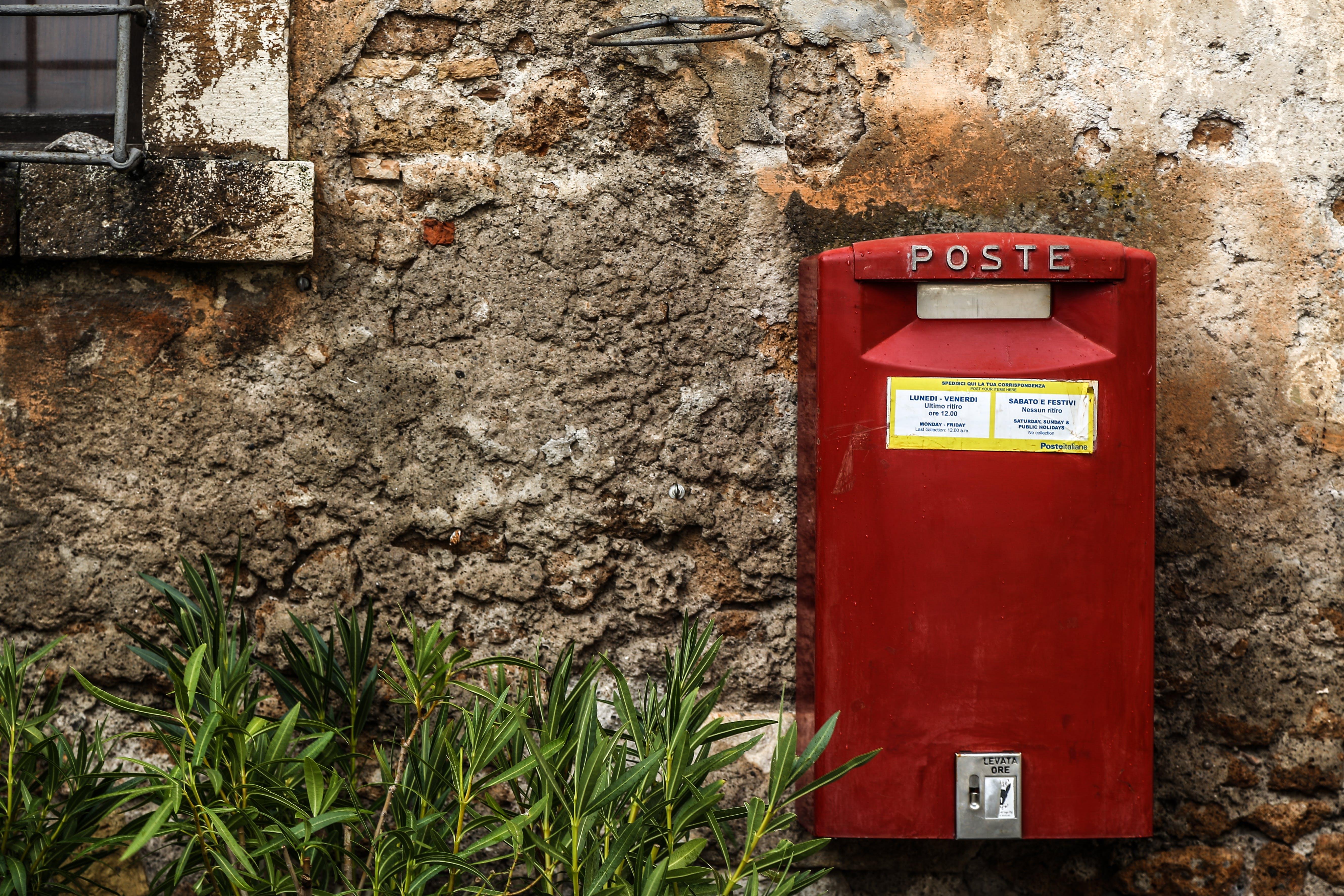 Red Mail Box Beside Green Grass