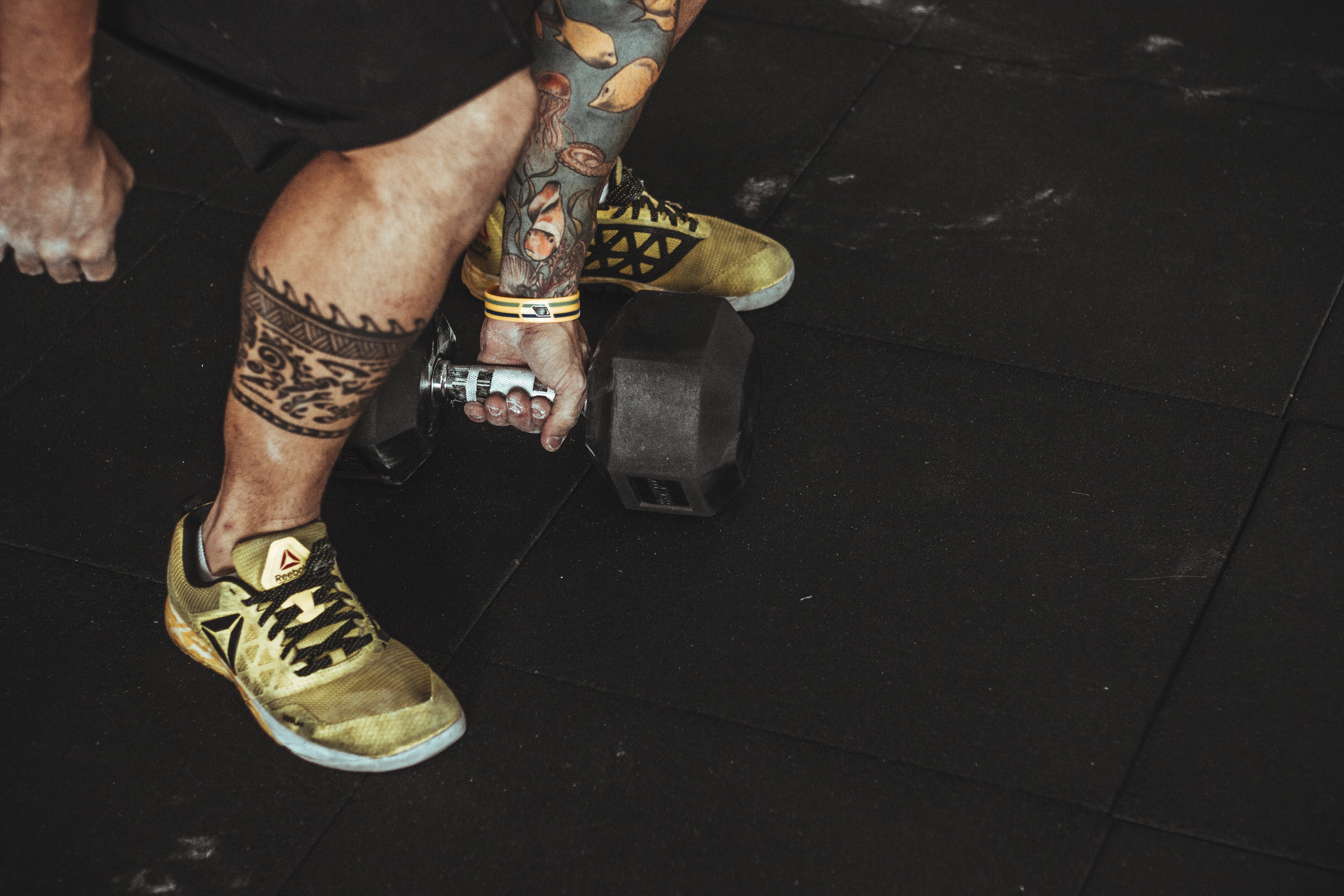 Man Wearing Yellow Running Shoes