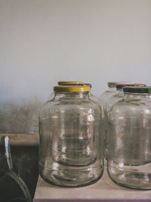 Glass Bottles With Lid On Table