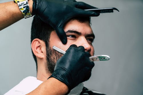 Person Shaving a Man's Face With Straight Razor