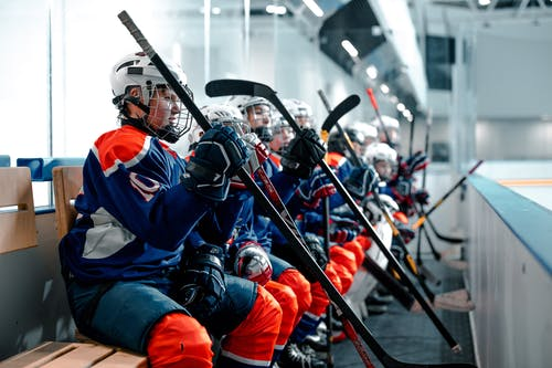 A Team of Hockey Players Sitting On A Bench