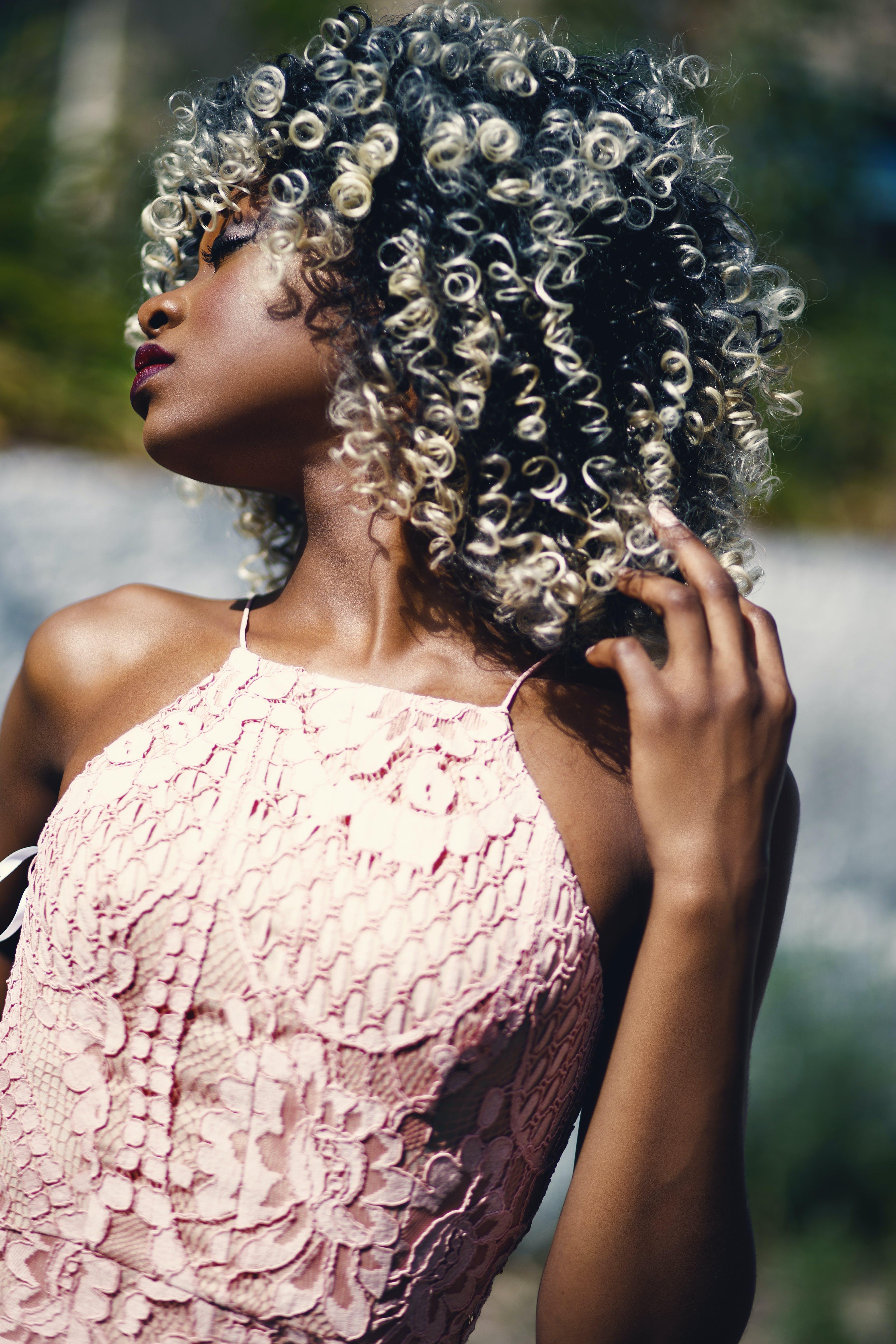 Woman Wearing 2-tone Beige Floral Spaghetti Strap Top