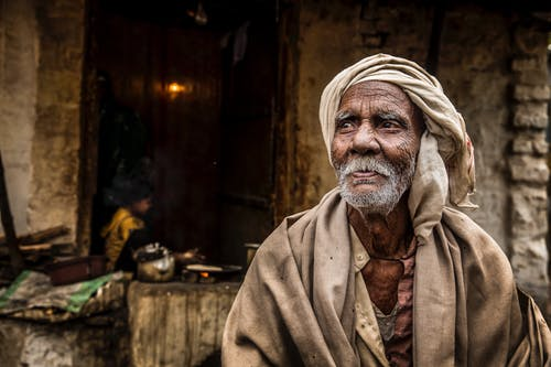Photo of An Old Man Wearing Headscarf