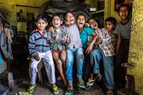 Photo of Children Sitting On A Bench Full of Happiness