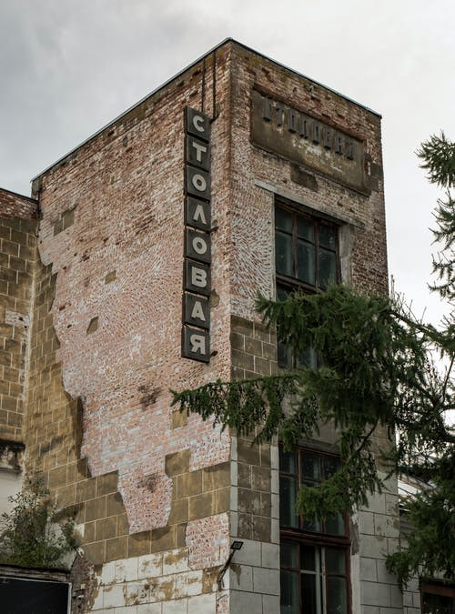 Old and Decaying Building With Signage